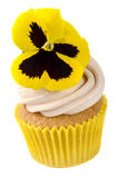 Madeira cupcake with edible pansy Stock Image
