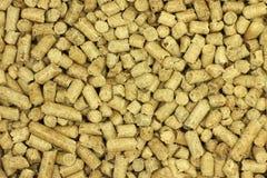 A madeira de combustível granula o fundo Fotos de Stock Royalty Free
