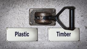 Madeira do interruptor da parede contra o plástico imagem de stock royalty free