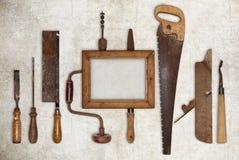 A madeira do trabalho da colagem utiliza ferramentas o carpinteiro e a moldura para retrato Imagem de Stock Royalty Free