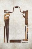 A madeira do trabalho da colagem utiliza ferramentas o carpinteiro que forma um quadro Imagem de Stock Royalty Free