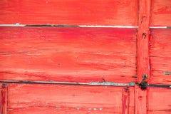 Madeira envelhecida pintada vermelho Imagem de Stock