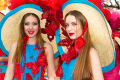 Madeira Flower Festival,  Portugal. FUNCHAL, MADEIRA, PORTUGAL - APRIL 19, 2015: Two young women in colourful costumes at the Flower Festival, Funchal, Madeira Stock Photography