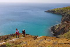 Madeira, Coastal Hiking Trail, Hikers Ascent. Hikers ascent on scenic Madeira coastal hiking trail. Atlantic Ocean and South coast view. Madeira island. Portugal Stock Photography