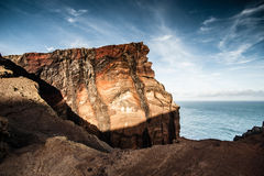 Volcanic coastline of Madeira island. Scenic view of volcanic coastline of Madeira island pictured at Ponta de Sao Lourenco, Portugal Royalty Free Stock Images