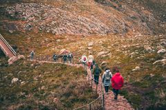 MADEIRA, PORTUGAL,25 February 2018: Group of hikers walking along the coastal path. Group of hikers walking along the coastal path Royalty Free Stock Photo