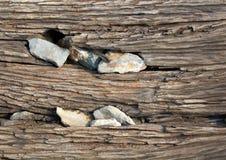 Madeira e pedras velhas imagens de stock