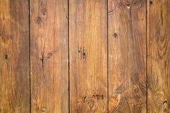 Madeira velha a um fundo da parede Imagem de Stock