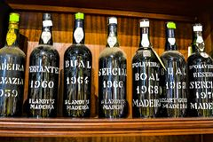 UNCHAL, MADEIRA / PORTUGAL - FEBRUARY 2017: MADEIRA VINTAGE WINE BOTTLES. MADEIRA VINTAGE WINE BOTTLES IN FUNCHAL CITY LIQUOR STORE stock photography
