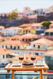 Madeira wine, coffee and bolo de mel with view to Funchal, Madeira, Portugal Royalty Free Stock Photos