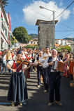 Madeira Wine Festival in Estreito de Camara de Lobos, Madeira, Portugal. Folk music group in local costumes performs  a folk dance at Madeira Wine Festival in Royalty Free Stock Photo