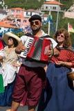 Madeira Wine Festival in Estreito de Camara de Lobos,. Folk music group in local costumes performs  a folk dance at Madeira Wine Festival in Esterito de Camara Royalty Free Stock Photo