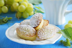 Madeleine cakes with grapes Stock Photos