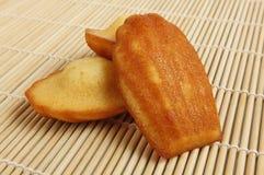 Madeleine-Kuchen/Biskuite Stockbilder