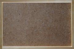 Madera contrachapada, fondo de la textura del panel duro con la frontera del marco de madera, Imagen de archivo