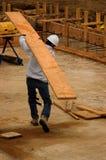 Madera de construcción que lleva Foto de archivo libre de regalías