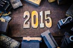 Madera 2015 del concepto y letras aherrumbradas del metal Foto de archivo