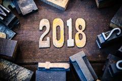 Madera 2018 del concepto y letras aherrumbradas del metal Fotografía de archivo