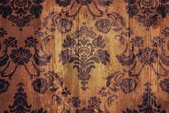 Madera del ornamento floral del fondo del Grunge Foto de archivo libre de regalías