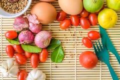 Madera del tomate del huevo de la comida Fotos de archivo