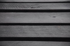 Madera negra de la pintura, una pieza del puente de madera Foto de archivo
