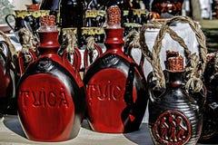 Madera tallada botellas Imágenes de archivo libres de regalías
