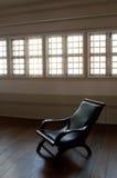 Madera vieja y silla de cuero Fotografía de archivo libre de regalías