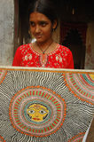 Madhubani painting in Bihar-India. August 21, 2009 –A village girl showing a traditional painting Stock Photography