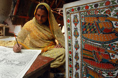 Madhubani painting in Bihar-India. August 21, 2009 –A woman making a painting Stock Photo