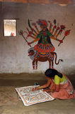 Madhubani painting in Bihar-India. August 21, 2009 –A woman making a painting Royalty Free Stock Photos
