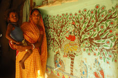 Madhubani painting in Bihar-India. August 21, 2009 –A woman painter with her child Royalty Free Stock Photography