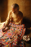 Madhubani painting in Bihar-India. August 21, 2009 –Madhubani,Bihar,India-A old man doing Madhubani painting Royalty Free Stock Image