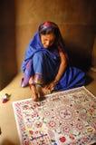 Madhubani painting in Bihar-India. August 21, 2009 –Madhubani,Bihar,India-A woman making a painting Royalty Free Stock Image