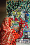 Madhubani painting in Bihar-India. August 21, 2009 –Madhubani,Bihar,India-A woman making a painting Stock Photo
