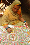 Madhuboni Painting in Bihar-India. August 21, 2009 A woman making a painting. Madhubani,Bihar,India-Maithil Paintings,commercially popular as Madhubani painting Royalty Free Stock Photo
