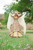 Madieval lady at outdoor. Royalty Free Stock Images