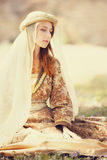 Madieval lady. Sitting at outdoor Royalty Free Stock Photos