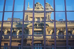 Madird. Old building reflected on a modern glass façade royalty free stock photo