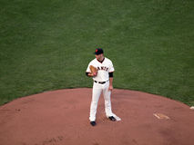 Madison Bumgarner stands on mound looking Stock Photo