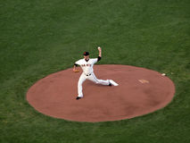 Madison Bumgarner steps forward to throws pitch Royalty Free Stock Image