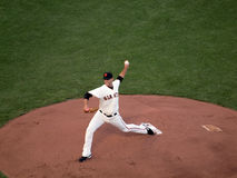 Madison Bumgarner steps forward to throws pitch Royalty Free Stock Photography