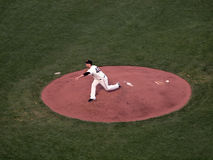 Madison Bumgarner steps to as he releases pitch Stock Images
