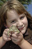 Madison and Hopper 2. Girl and Frog Stock Photos