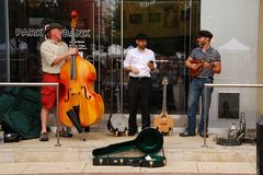 MADISON, WI - JULY 26th, 2014:  Musicians take a break during a weekly Farmer's Market on the Wisconsin Capitol Square Stock Photos