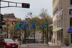 Street Sign Artwork. MADISON, WISCONSIN - May 10, 2014: A sidewalk art display of street signs with funny sayings in Capital Square in Madison, WI on May 10 royalty free stock photography