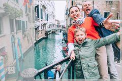 Madly happy family take a selfie photo on the one of bridge in Venice. Travel around the wolrd with kids concept image royalty free stock photo