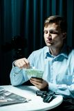 Madman counting money for murder royalty free stock photos