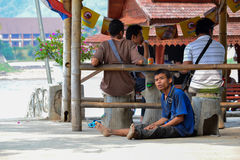Madman. At Laos is sitting and see the people around him Stock Photos