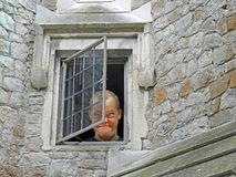 Madman looking out from asylum window royalty free stock image