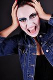 Madness. Mad girl with clown make-up Royalty Free Stock Images